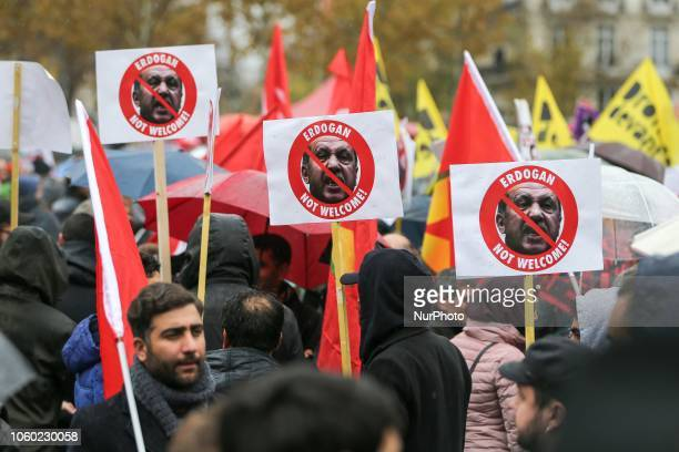 Demonstators holds signs against Turkish President Recep Tayyip Erdogan at the Place de la Republique in central Paris on November 11 as leaders from...