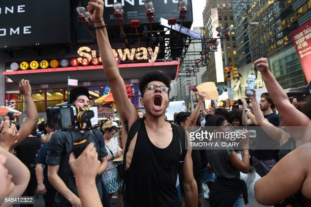 TOPSHOT Demonstators march through the city to call for justice for Alton Sterling and Philandro Castile as they rally in the middle of Times Square...