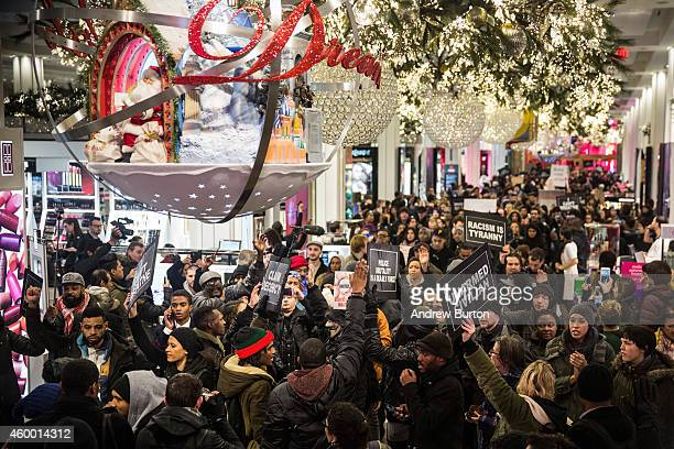 Demonstraters storm the Macy's on 34th Street protesting the Staten Island New York grand jury's decision not to indict a police officer involved in...