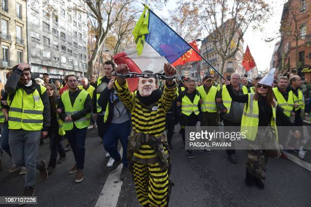 Demonstraters take part in a protest of Yellow vests against rising oil prices and living costs in Toulouse southern France on December 1 2018
