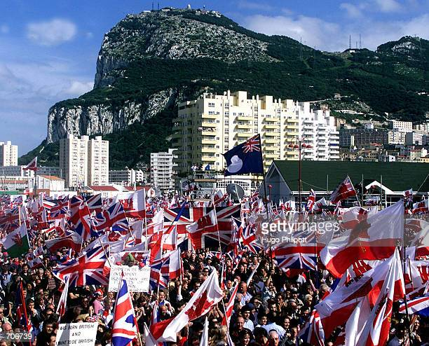 Demonstraters wave flags to protest their potential loss of sovereignty to Spain March 18 2002 in Gibraltar Britain has recently opened discussions...