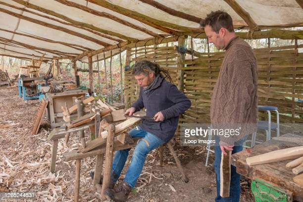 Demonstrating how to use a draw knife on a shaving horse.