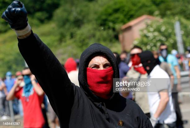 Demonstrating miner gestures after he and others blocked off the N66 national highway in Campomanes, near Oviedo in northern Spain on May 30, 2012....