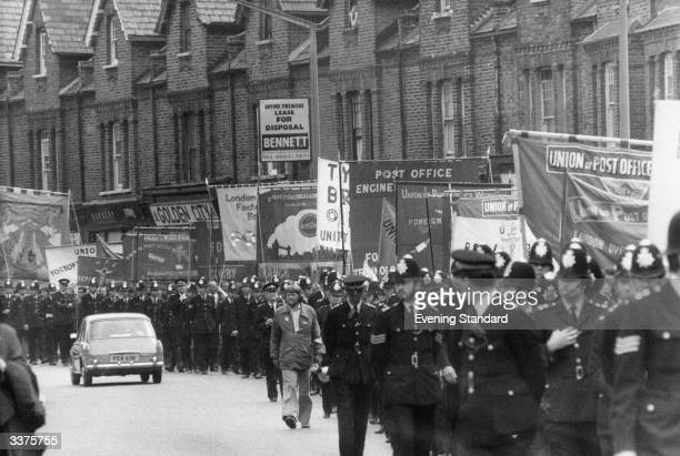Demonstrating postal workers marching through the streets of London in support of the industrial action at Grunwick photoprocessing Laboratory in...