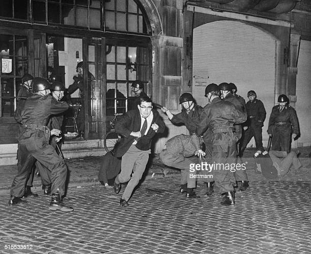 A demonstrating student about to ward off a blow from a truncheon wielding state trooper during the second day of riots by Flemish students of the...