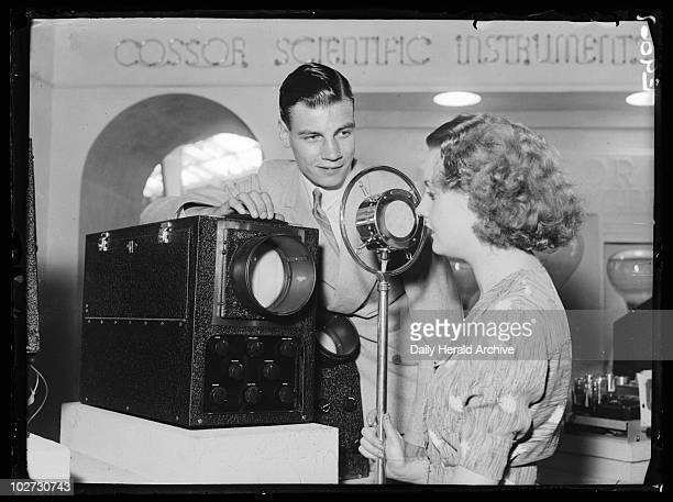 Demonstrating the Cossor oscillograph Radiolympia London 1936 A photograph of a woman talking into a Cossor oscillograph taken by Bishop Marshall for...