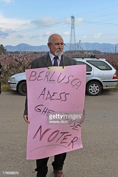 """Demonstration against nuclear power at the Garigliano nuclear power plant, Italy. The sign exposed by the protester said: """"Berlusconi, now we think..."""