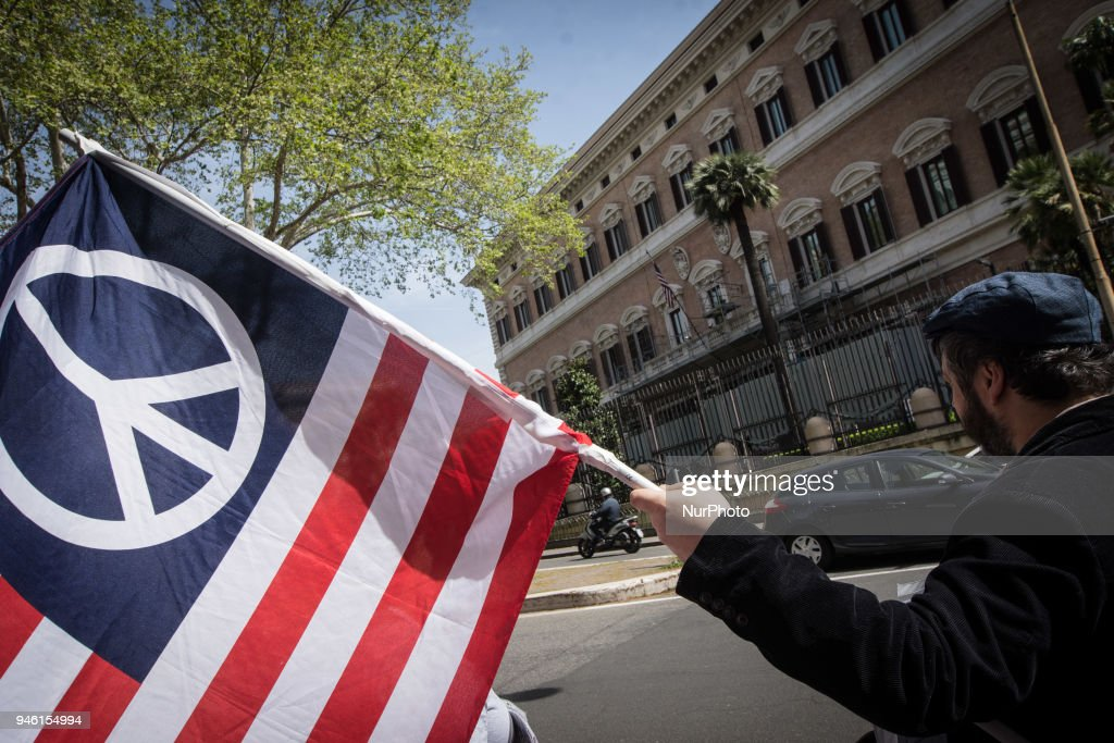 ,Demonstration against the military action in Syria in front of the US embassy in Rome, Italy, 14 April 2018. USA, Britain and France launched airstrikes targeting three sites allegedly related to the Syrian government's chemical weapon capabilities. on April 14, 2018 in Rome, Italy