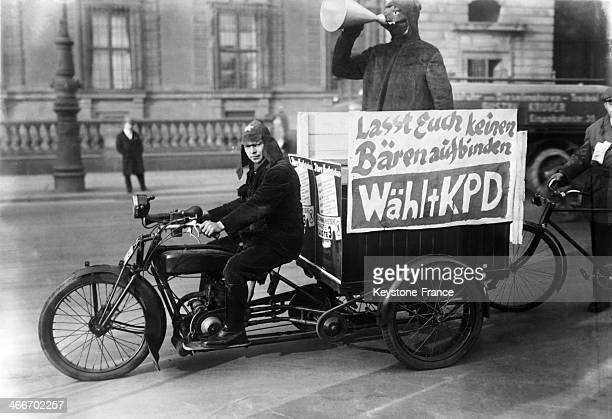 Demonstration against the Young Plan, a program for the settlement of German reparations debts after World War I, with banderole and megaphone, in...