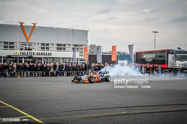 Demonstration and donut action as the FA1 race car burns some rubber, at the Acceleration 2014 Presentation, Theater Hangaar Valkenburg, The...