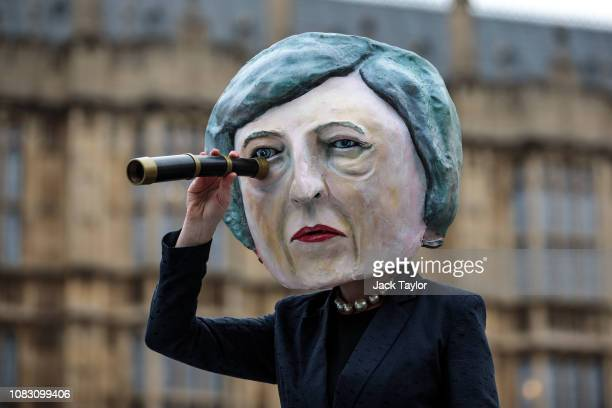 A demonstration featuring a paper mâché Theresa May head is staged by campaign group Avaaz outside the Houses of Parliament on January 15 2019 in...