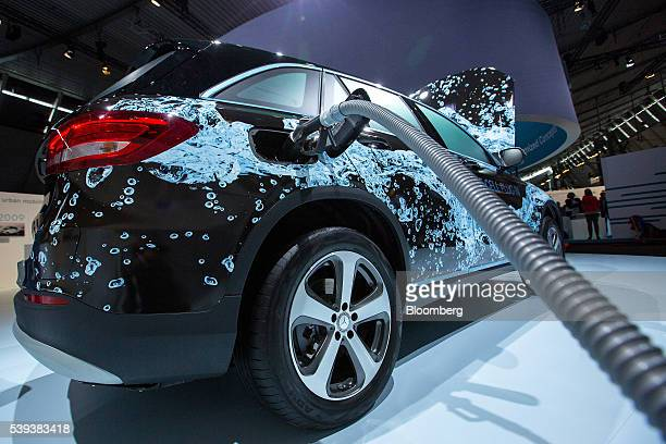 A demonstration hydrogen fuel pump sits connected to a prototype MercedesBenz GLC FCell hybrid plugin SUV automobile during Daimler's TecDay Road to...