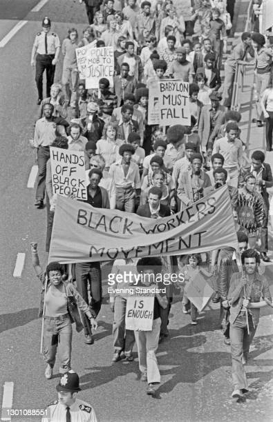 Demonstration in Brixton, south London, by the Black Workers' Movement , UK, 4th July 1973. One placard reads 'Babylon Must Fall'.