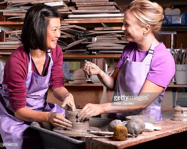 demonstration in potters studio by potter teacher