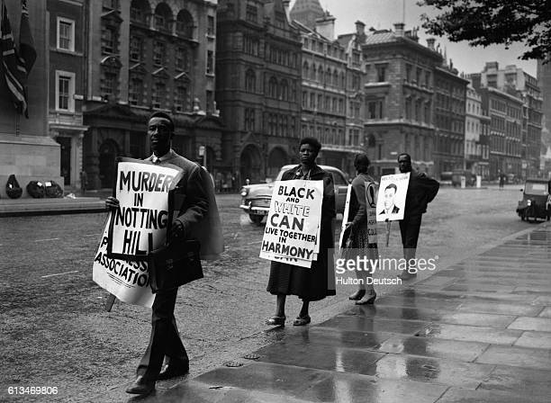 A demonstration in Whitehall London organised by the Coloured People's Progressive Association The protesters carry posters and placards including a...