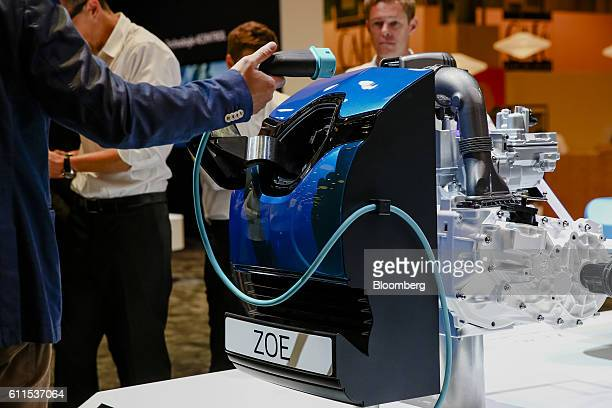 Demonstration model electrical charging point for a new battery-powered Zoe city car, manufactured by Renault SA, sits on display during the second...