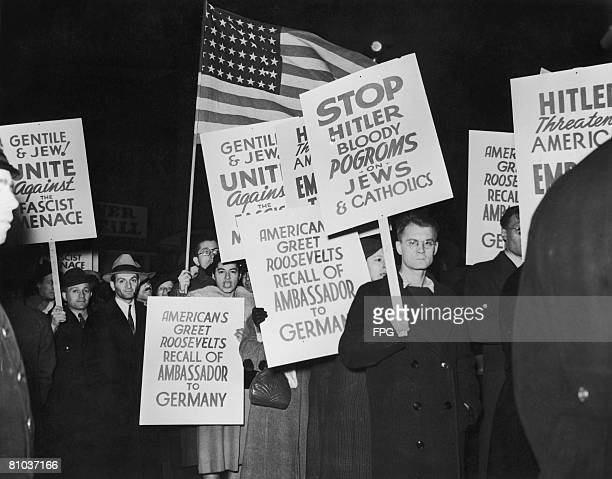 A demonstration near the German ocean liner SS Bremen in New York after Hugh Wilson the American ambassador to Germany was recalled in the wake of...