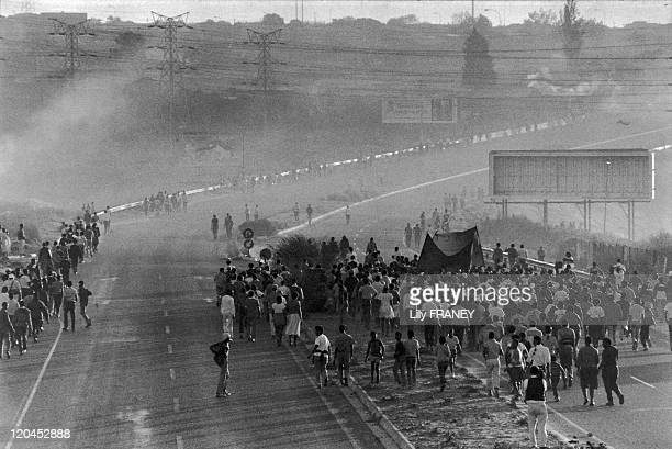 Demonstration of ANC in Soweto South Africa in 1989 Demonstrators of the African National Congress walk on the highway of Soweto