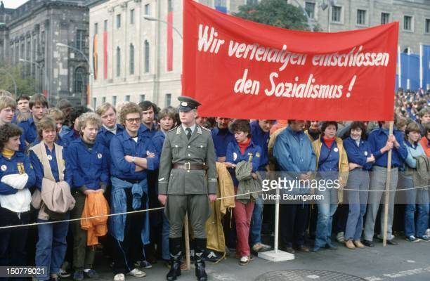 Demonstration of the Freie Deutsche Jugend In the front a soldier of the Nationale Volksarmee NVA