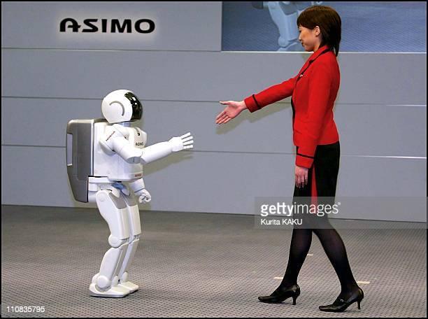 Demonstration Of The New Honda Humanoid Robot Asimo In Tokyo Japan On December 12 2002 Honda's humanoid robot ASIMO extends his hand to a Honda...