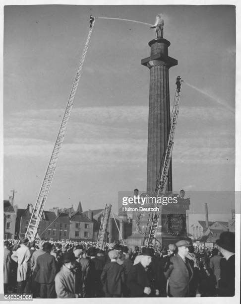 Demonstration of the old and the new ladders used by Hull fire brigade at the William Wilberforce statue in the city. The new Leyland turntable...