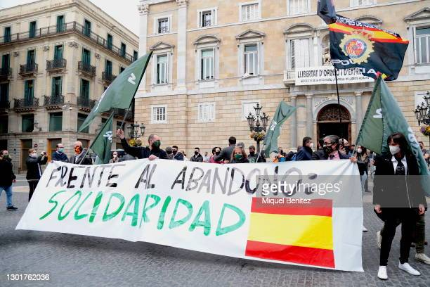 Demonstration of the Union of the National Police Corps and the Spanish Civil Guard is seen showing a banner which was attended by representatives of...
