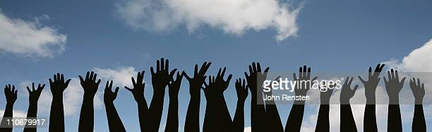 demonstration or festival? hands in the air - democracy stock pictures, royalty-free photos & images