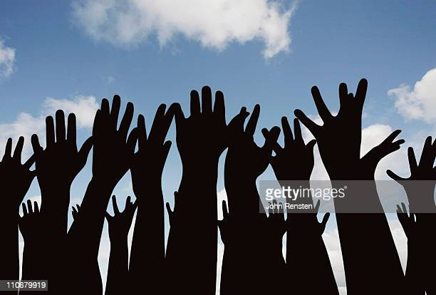 demonstration or festival? hands in the air - citizenship stock pictures, royalty-free photos & images