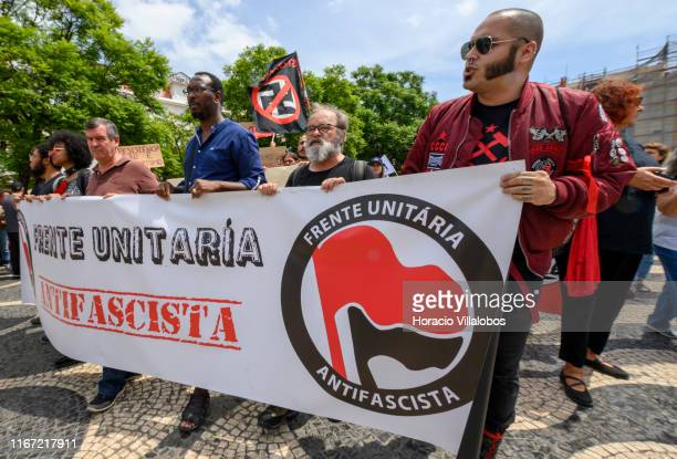 Demonstration organizer Jonathan Ferreira da Costa from Frente Unitaria Antifascista parades in a national anti-fascist rally from Rossio Square to...