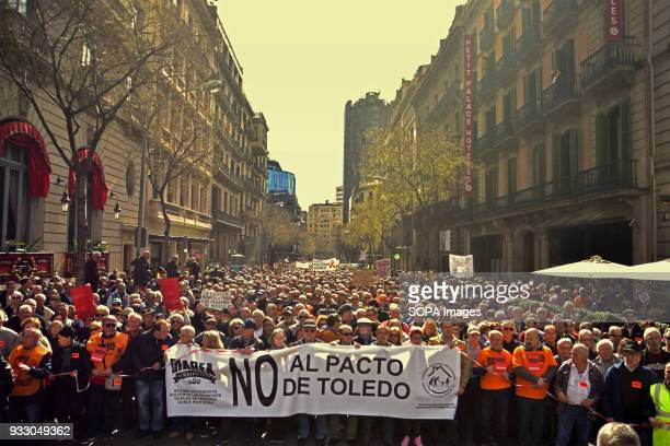 Demonstration seen holding a banner at the front of the march Ten of thousands of pensioners took to the street of Barcelona during a protest called...