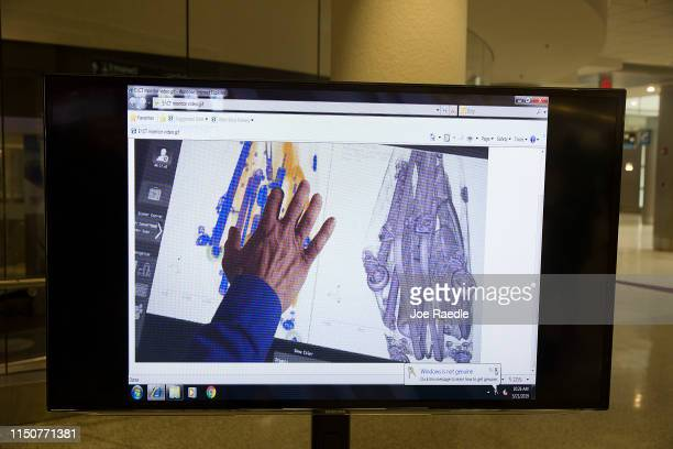 A demonstration video shows a screen replicating what is seen in the Transportation Security Administration's new 3D scanner at the Miami...