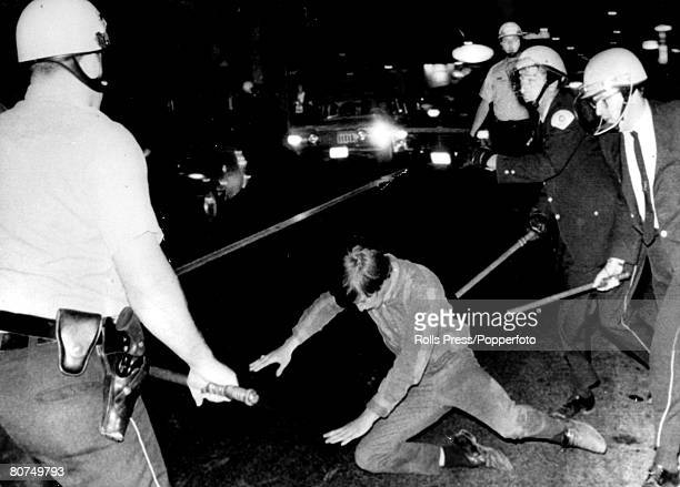 28th August 1968 Police knock down a antiVietnam War demonstrator during a anti war demonstartion outside the Democratic Convention Hall