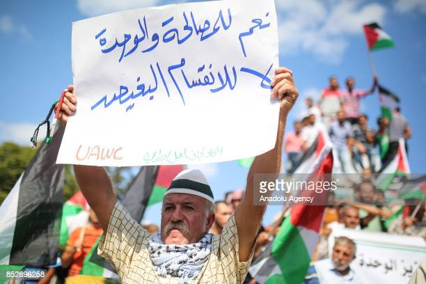 Demonstrations hold placards as they march towards alSaraya Square during a protest against the blockade that carried out by Israel for eleven years...
