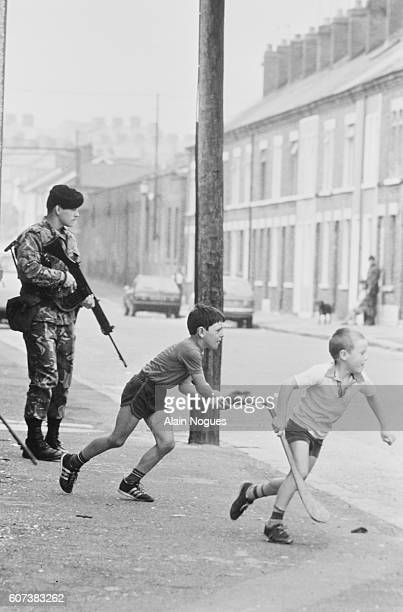 Demonstrations in the Protestant area of Belfast provoke unrest in Northern Ireland's capital but children play in the streets heedless of the...