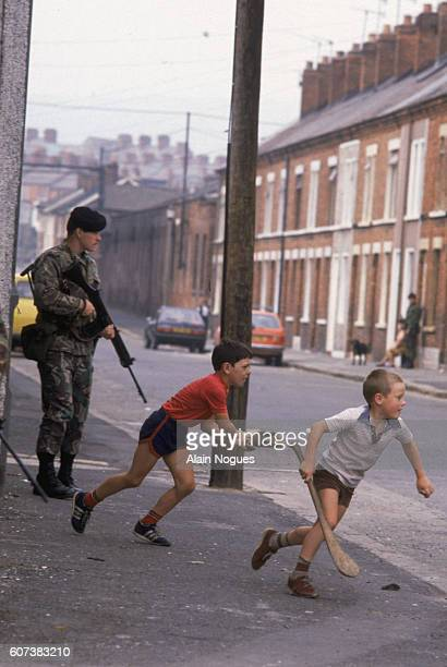 Demonstrations in the Protestant area of the city provoke unrest in Northern Ireland's capital but children play in the streets heedless of the...