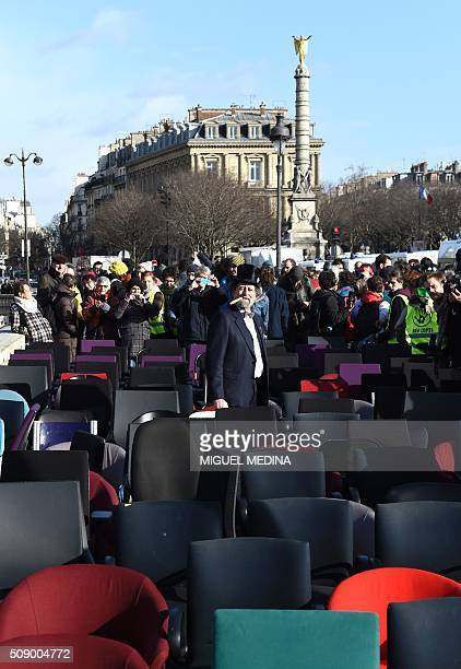 A demonstrator among chairs taken from bank offices poses on February 8 2016 on the pont au change near the Court of Paris during a demonstration...