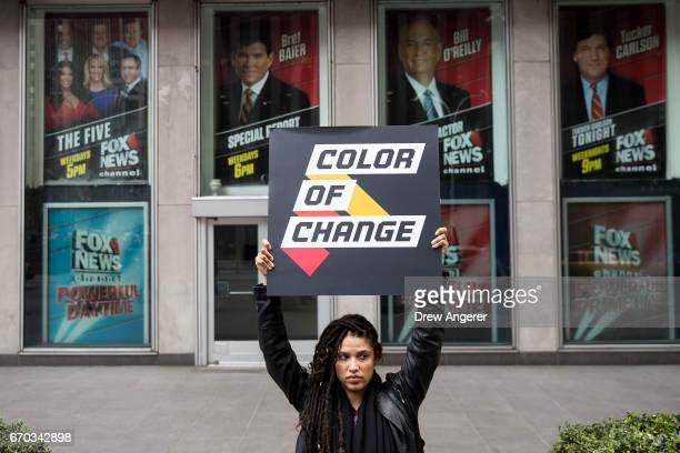 Demonstrator Anna Collier Navaroli holds a sign outside of the News Corp and Fox News headquarters in Midtown Manhattan April 19 2017 in New York...