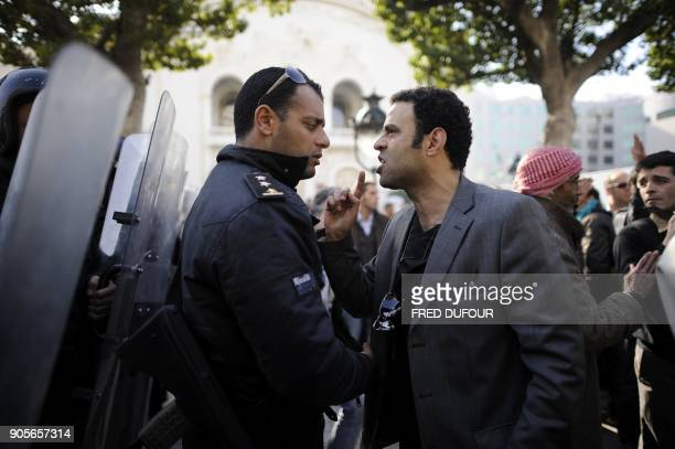 A demonstrator argues with a policeman during a protest in the center of Tunis on January 17 2011 Hundreds of people rallied in central Tunis on...