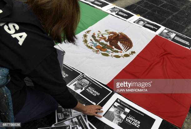 Demonstrator arrange portraits of Mexican journalist Javier Valdez, murdered in Culiacan, Sinaloa, Mexico on May 15, during a protest in front of...