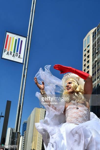a lgbtq demonstrator at sao paulo's gay pride parade or lgbtq parade - carlos alkmin stock pictures, royalty-free photos & images
