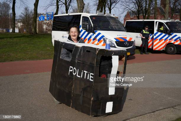 Demonstrator attended with a police car made of cardboard at the demonstration held on February 20, 2021 in The Hague, Netherlands. Organised by the...
