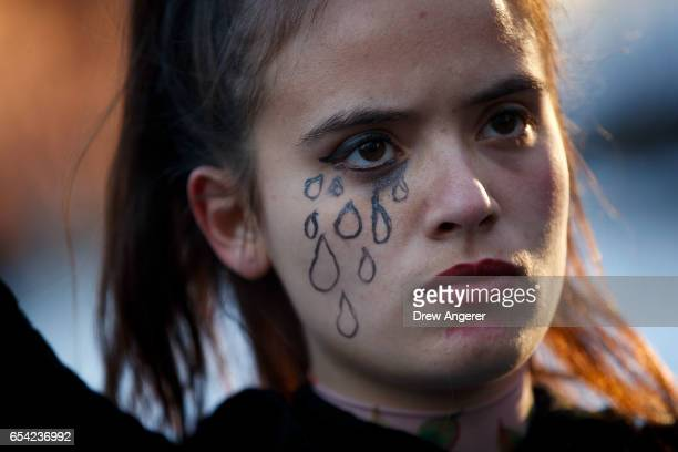A demonstrator attends a small protest of President Donald Trump's proposed travel ban and suspension of the country's refugee program March 16 2017...