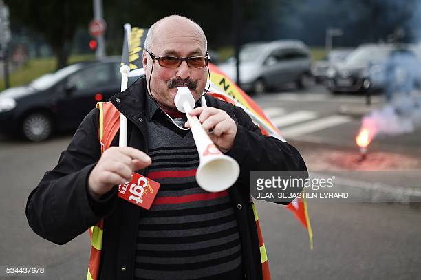 A demonstrator blows on a horn on May 26 2016 in Nantes western France during a protest against government planned labour law reforms The French...