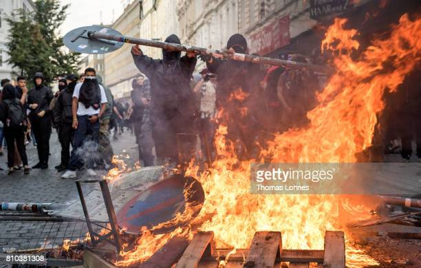 Demonstrator built a burning crush barrier during a demonstration against the G20 Summit on July 7 2017 in Hamburg Germany Leaders of the G20 group...