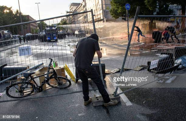 Demonstrator built a crush barrier during a demonstration against the G20 Summit on July 7 2017 in Hamburg Germany Leaders of the G20 group of...