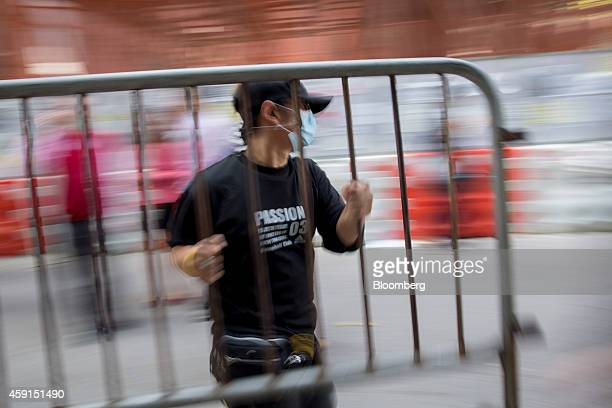 A demonstrator carries a dismantled barricade outside Citic Tower in the Admiralty district of Hong Kong China on Tuesday Nov 18 2014 Hong Kong's...