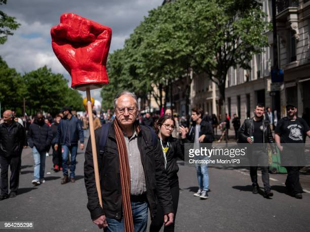 A demonstrator carries a fist raised in the middle of the crowd during the May 1 demonstration on May 1 2018 in Paris France The demonstration was...