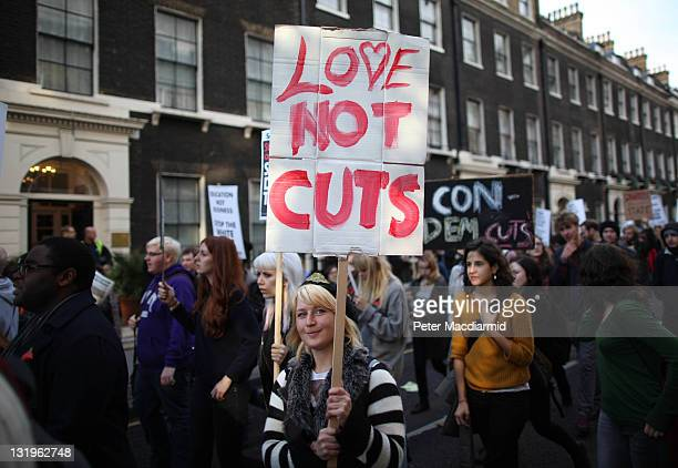 A demonstrator carries a placard as students take part in a demonstration against higher tuition fees and privatisation in universities on November 9...