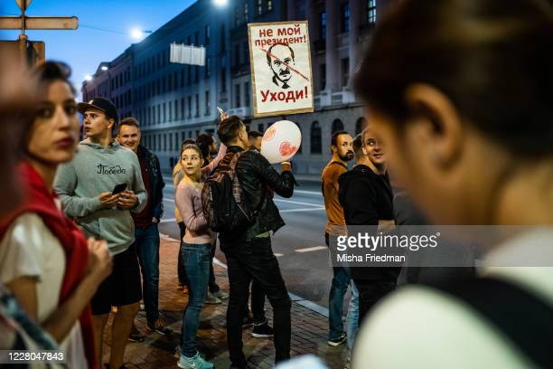 """Demonstrator carries a sign that reads """"Not my President, Leave"""" during an opposition rally on August 14, 2020 in Minsk, Belarus. There have been..."""