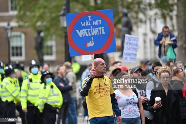 Demonstrator carries an anti-vaccination sign at a protest action against restrictions imposed during the novel coronavirus COVID-19 pandemic,...